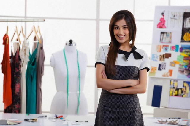 Portrait of a woman in a design studio --- Image by © Hemant Mehta /India Picture/Corbis