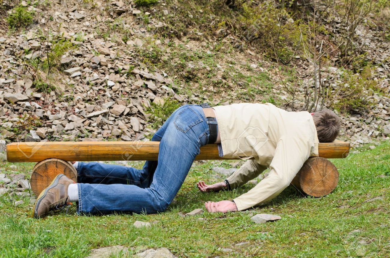 19800488-Young-man-deeply-sleeping-or-drunk-laying-outdoors-on-a-wooden-park-bench-Profile-view-Stock-Photo